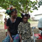 One of our beneficiaries from Makeni, who has now been given a new limb, with her mother