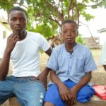 One of our beneficiaries from Makeni, who has now been given a new limb, with his brother