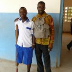 One of our beneficiaries in Sierra Leone, who has now been given a new limb, with his father