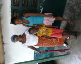 ELoH beneficiary Ruth, 15, who lost her leg after being hit by a stray bullet during Liberia's civil war, with her family