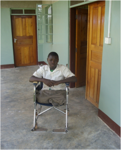 Roger in his wheelchair, waiting outside the new ELofH sponsored limb centre. He lost both legs when he fell into a charcoal burner as a small child.