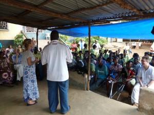 Sarah-talking-to-beneficiaries-at-freetown-300x225
