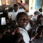 Boys excited by the camera of ELoH trustee Victoria