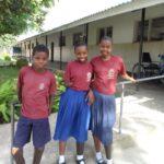 Baraka, 11, Maria, 12, and Mofa, 13, outside Matumaini school with their new prosthetics