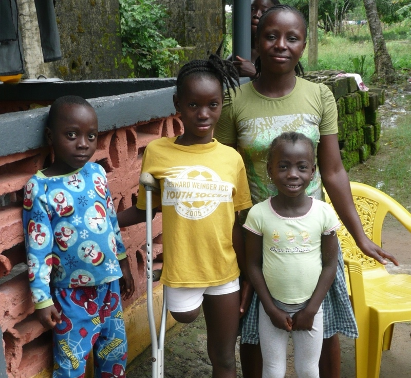 ELoH beneficiary Victoria, 11, who lost her leg after a wound became badly infected,  with her mother and siblings