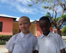 Two Matumaini children pose for the camera