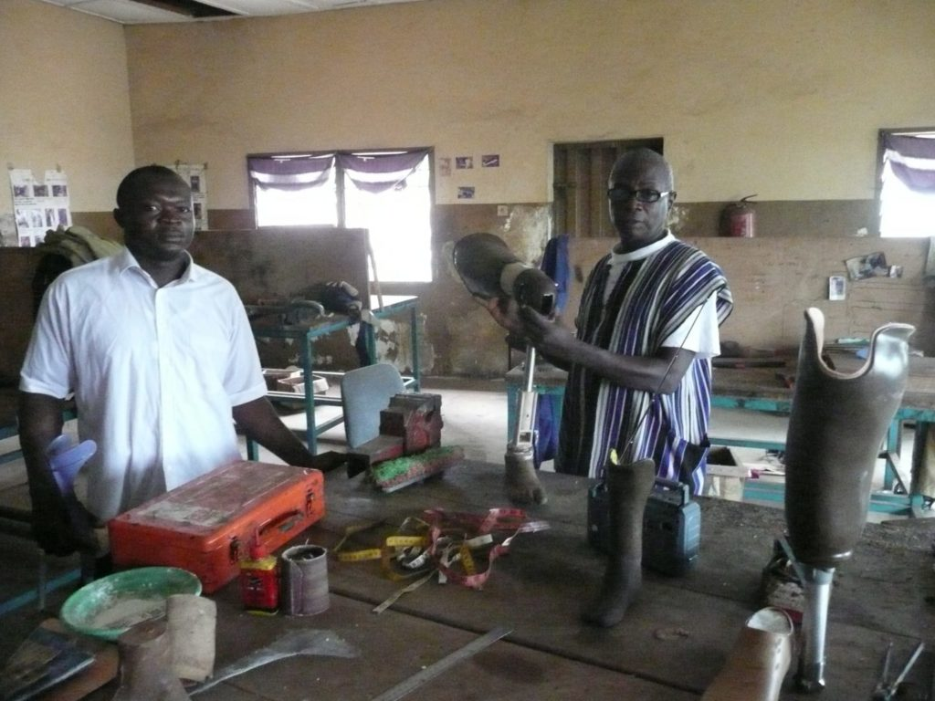 Technicians in the prosthetics workshop in Freetown in May 2014 before Ebola.