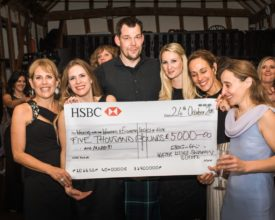 Victoria receiving cheque at Water Lilies' Charity Ball