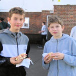 children enjoying a buttie sandwich