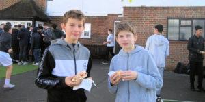children enjoying a buttie sandwich