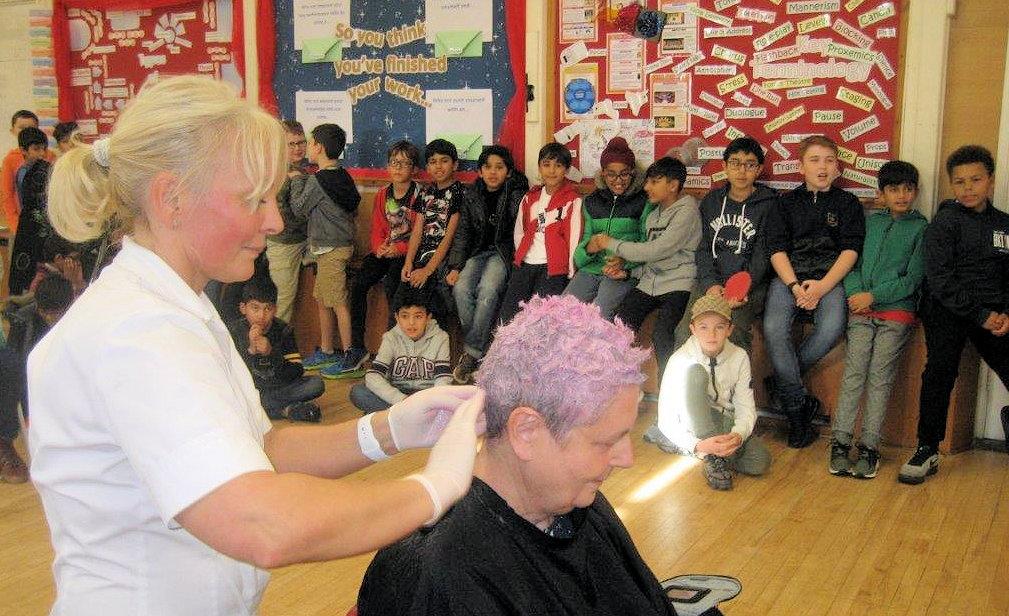 Teach having her hair dyed pink